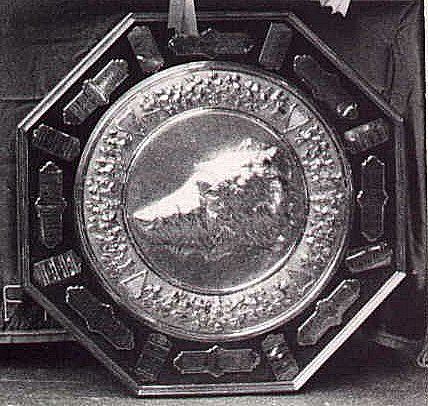 silver shield with wolfhound head