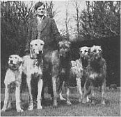 Charles Gardner with group of hounds