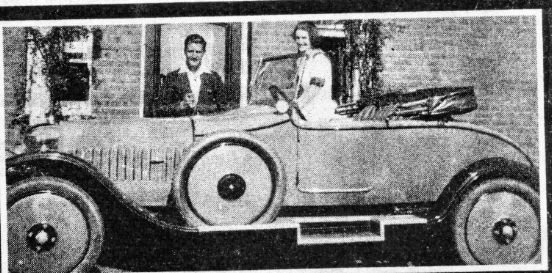 Phyllis in one of the cars