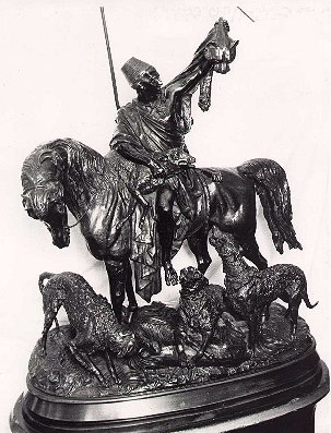 bronze of man on horse with hounds